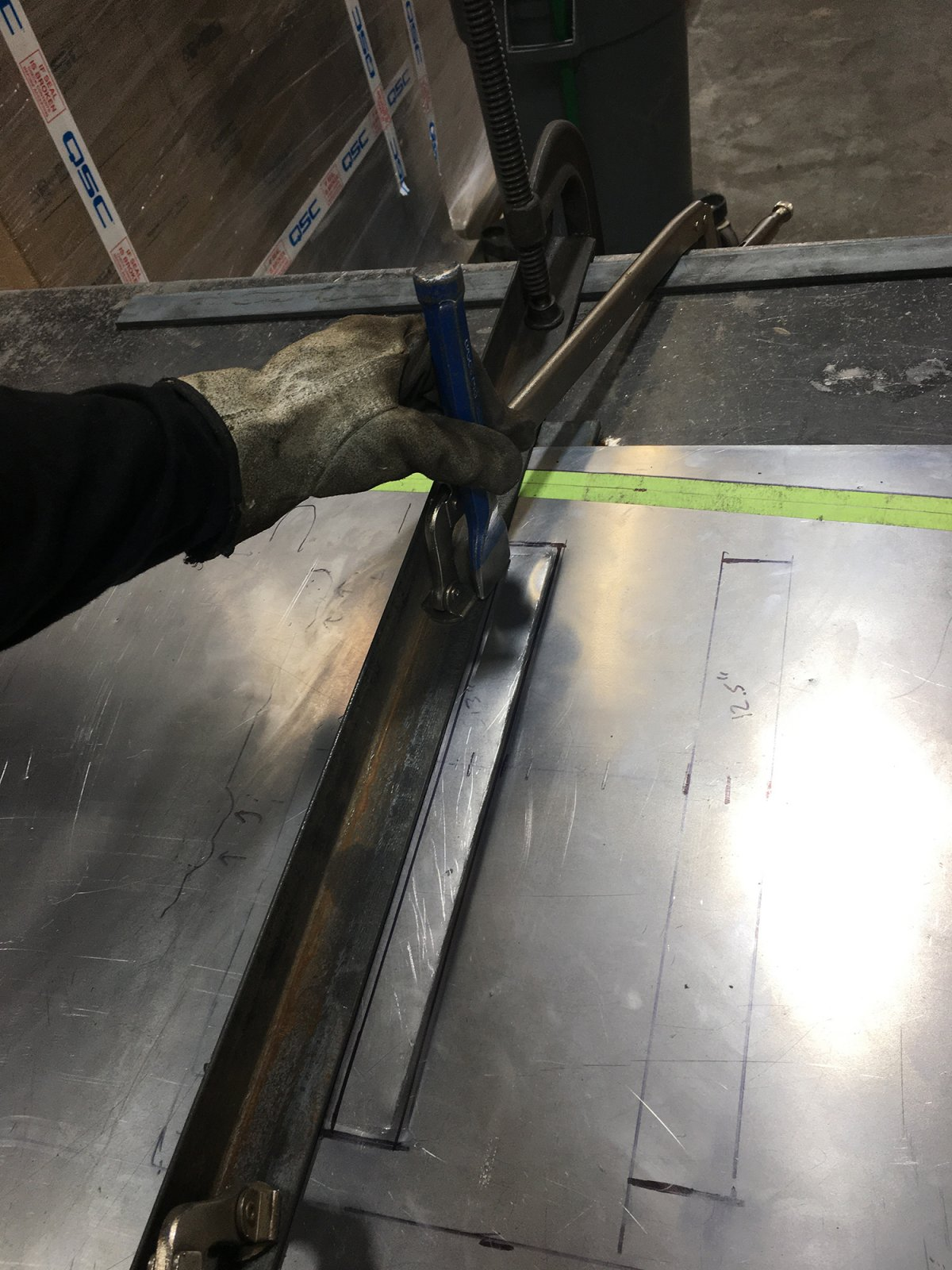 Tyler created ribs using a hammer and chisel. Ribs add rigidity and strength to an otherwise flimsy piece of sheet metal.