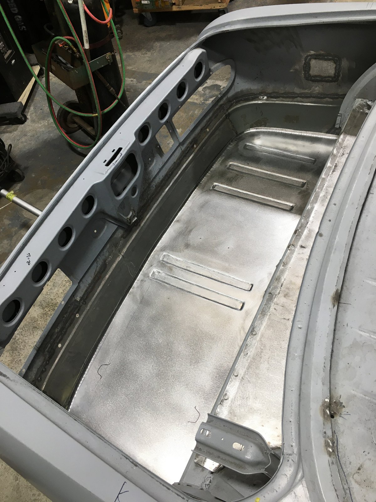 She drops beautifully into the car to create a clean floor. The sections without ribs are where our devices will be mounted.
