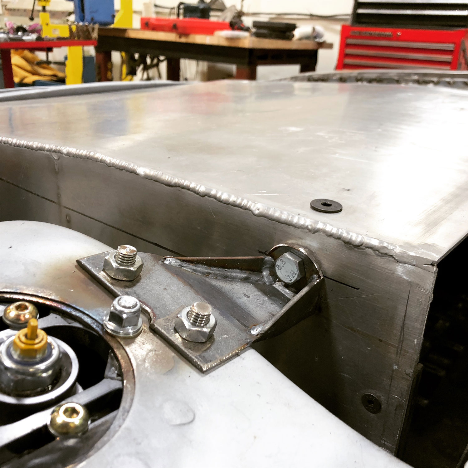 Each corner of the box has brackets to secure it to the car. The corners of the box are steel reinforced on the inside for this purpose and also for living the box.