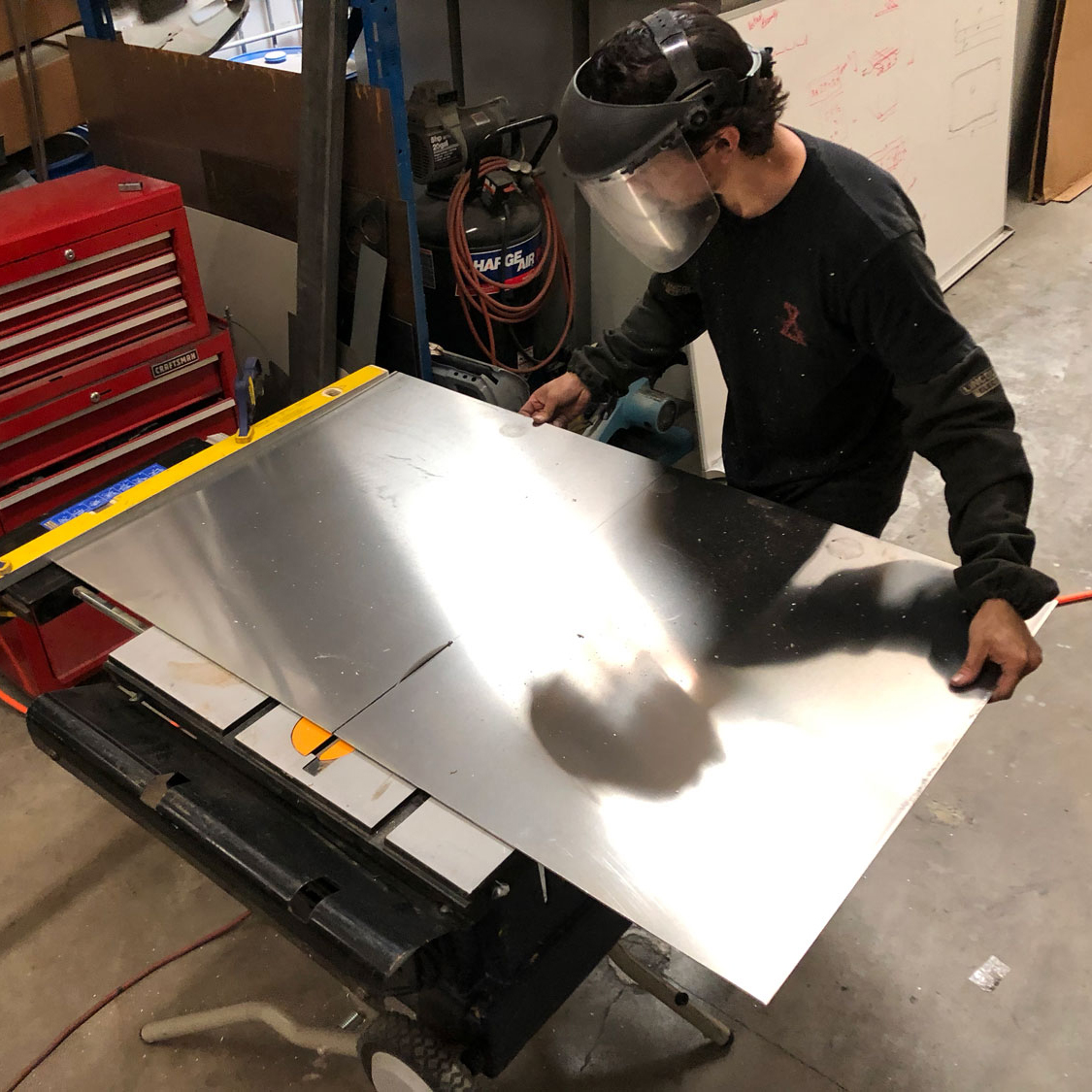 Aluminum cuts smooth and easy on a tablesaw as f it were a piece of thin plywood.
