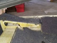 carpet gap outbrd under front seat.jpg